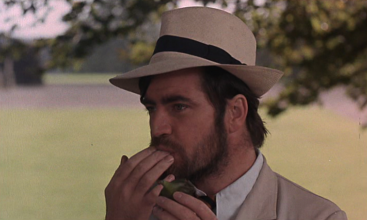 The erotic eating of a fig. Alan Bates as Rupert in WOMEN IN LOVE, 1969