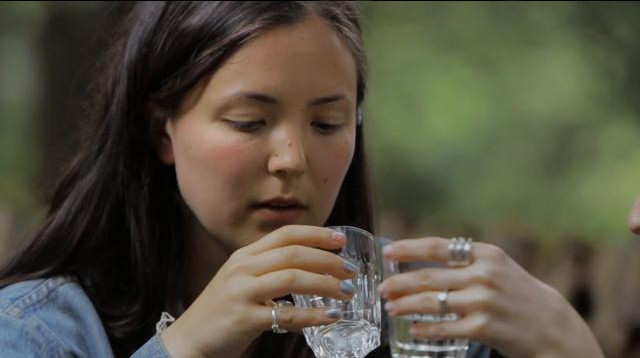 """What is that drink called again?"" Isolde Chae-Lawrence drinks it all down in Josephine Decker's Butter on the Latch, 2013. Cinematography 