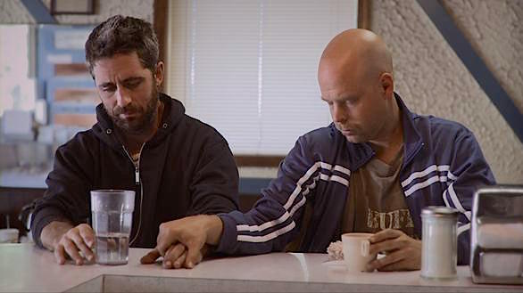 Colm O'Leary and Will Oldham attempt to form a friendship for what appears to be two very different reasons.  New Jerusalem, Rick Alverson, 2011