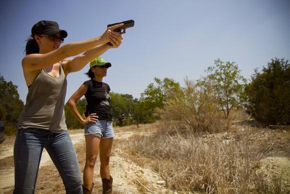 Trieste Kelly Dunn learns to shoot her gun with the help of Melissa Bisagni who earnestly wants to help . Loves Her Gun, 2014. Cinematography | Amy Bench