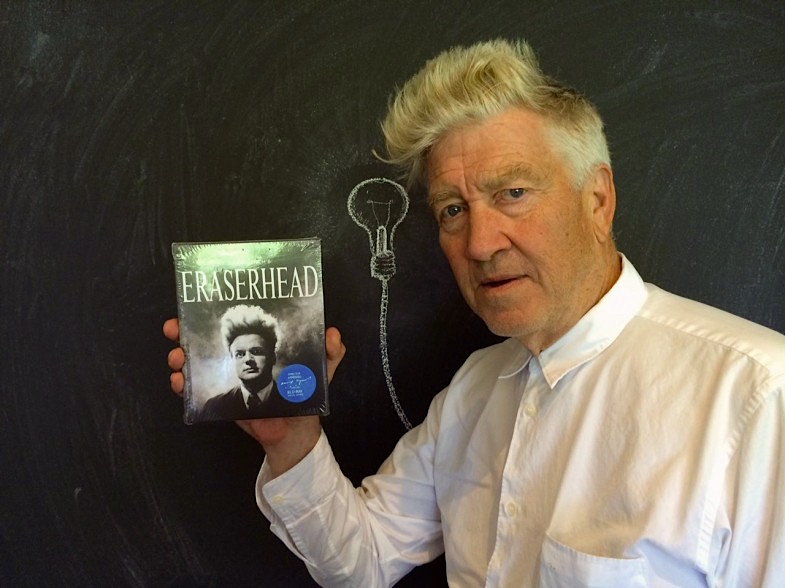 """Mother, they're still not sure it is a baby! "" American Filmmaker, David Lynch, holds the first printed copy of Criterion's re-stored ""Eraserhead"" blu-ray. David Lynch, 2014"