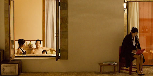 The family relaxes in the warmth while their housemaid sits patiently in the cold. Jeon Do-yeon as The Housemaid / Hanyeo Sang-soo Im, 2010 Cinematography | Lee Hyung-deok