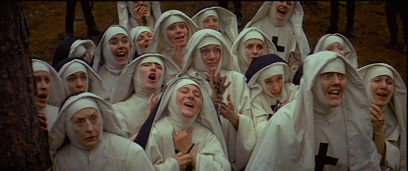 "All the nuns are gathered to stand in giant burrial holes and ""suggested"" to convulse, blaspheme, carnally degrade themselves for the ""good"" of God. Or faces the same torture imposed upon their  Superior Mother. They are all eager to follow The Cardinal, The King and The Exorcists' guidance for transgressive behavior.  The Devils Ken Russell, 1971 Cinematography 