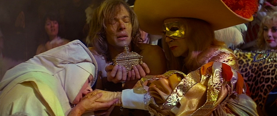 The King and his Royal Court make an appearance to giggle at the atrocious perversion of The Catholic Church.  The Devils Ken Russell, 1971 Cinematography | David Watkin