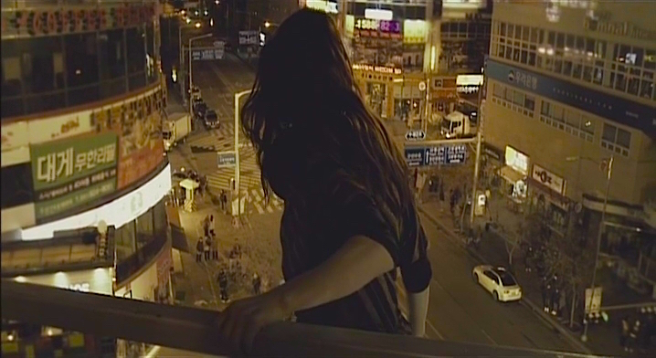 A the South Korean Economic Gap Between Wealth and Poverty Grows, a woman plunges to her death. The opening sequence of The Housemaid / Hanyeo Sang-soo Im, 2010 Cinematography | Lee Hyung-deok