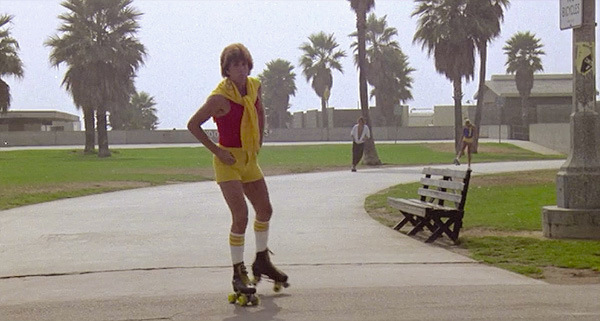 Whoa! Wait. Is that the leading man? Oh, yes. Well he is ONE HOT HUNK OF A MAN!!! ...in mini-shorts, tube socks, skating around Venice Beach. No worries.  Jim Bray doing his best Roller Boogie Marl L. Lester, 1979 Cinematography | Dean Cundey
