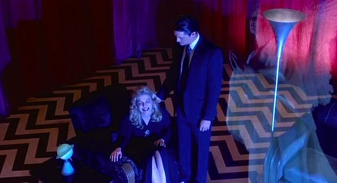 "Together in a dream or some alternate universe. Laura Palmer has a worrying connection to Special Agent Cooper. ""I'll see you again in 25 years. Meanwhile..."" Sheryl Lee & Kyle MacLachlan Twin Peaks: Fire Walk With Me David Lynch, 1992 Cinematography 