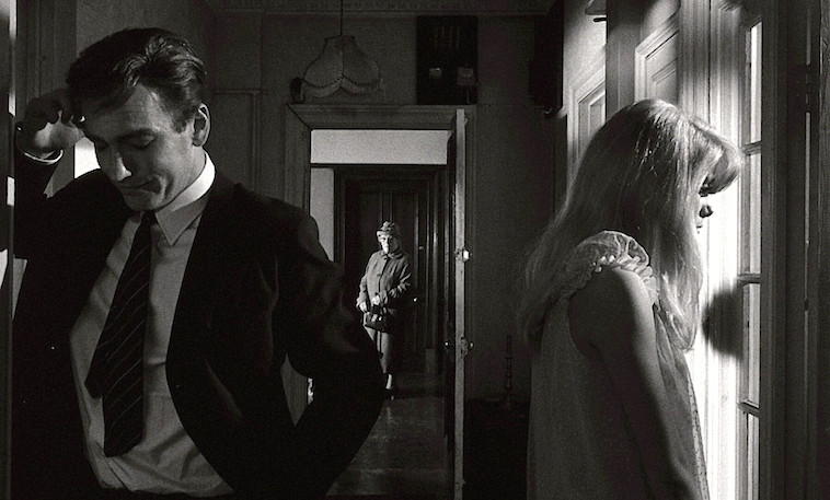 Does this potential suitor really have good intentions? If so, why did he break the door's lock to secure access to Carol's apartment? A nosy neighbor watches from the hall. John Fraser & Catherine Deneuve REPULSION Roman Polanski, 1965 Cinematography | Gilbert Taylor