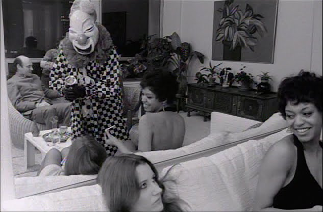 "A drunken/stoned gathering quickly devolves into an uncomfortable challenge of group sex and sexual identity... Sally Kirkland is disengaged as ""Sarabelle"" The Clown hits on Joe... Coming Apart Milton Moses Ginsberg, 1969 Cinematography 
