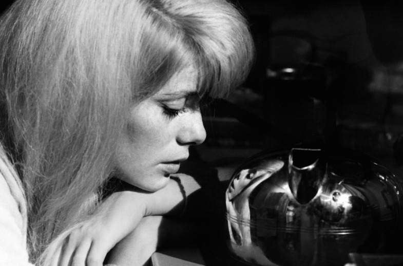 Catching her reflection in a vase, Carol seems transfixed by the contour's warped perspective. Catherine Deneuve REPULSION Roman Polanski, 1965 Cinematography | Gilbert Taylor