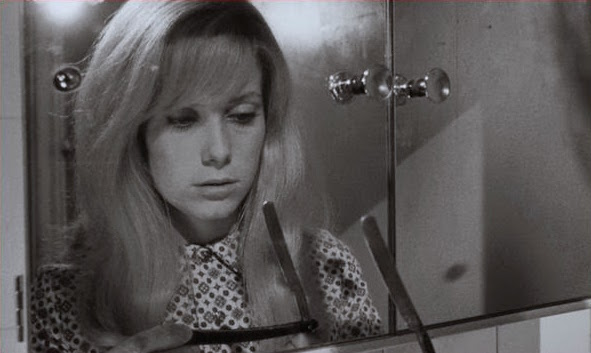 Studying a straight razor. Catherine Deneuve REPULSION Roman Polanski, 1965 Cinematography | Gilbert Taylor