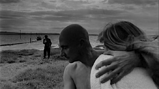 Threat before them. The criminal stands with menace and the couple appears afraid. Or are they? Lionel Stander, Donald Pleasance & Françoise Dorléac Cul-de-Sac Roman Polanski, 1966 Cinematography | Gilbert Taylor
