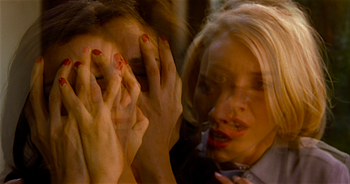 Identities merge, split, engage and threaten reality beyond recognition. Laura Harring / Naomi Watts Mulholland Drive David Lynch, 2001 Cinematography | Peter Deming