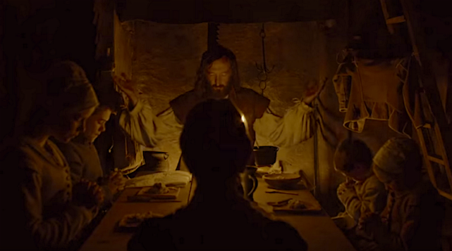Ralph Ineson as the father leads his family in prayer before they begin to eat a very sparse dinner. The Witch Robert Eggers, 2016 Cinematography | Jarin Blaschke