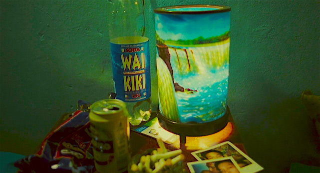 Drink, polaroids and cigs seem to fight for light. Happy Together Kar-wai Wong, 1997 Cinematography | Christopher Doyle