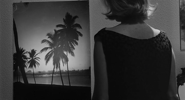 A poster seems to be offering an escape, but it could be a trap of another sort. L'Eclisse Michelangelo Antonioni, 1962 Cinematography | Gianni Di Venanzo